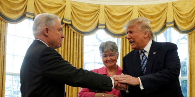 U.S. President Donald Trump congratulates Jeff Sessions after he was sworn in as U.S. Attorney General...
