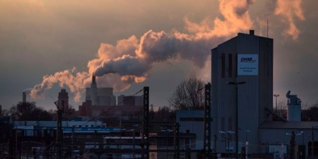 The sun sets on Berlin's Westhafen area on March 1, 2017, as a waste treatment plant releases vapor in...