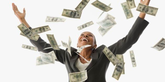 African American businesswoman throwing money in the