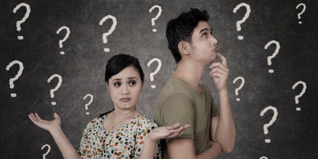 Confused couple with question marks on