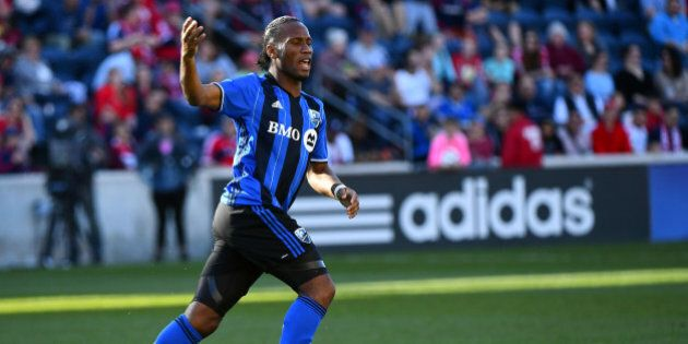 Apr 16, 2016; Chicago, IL, USA; Montreal Impact forward Didier Drogba (11) reacts after scoring a goal...