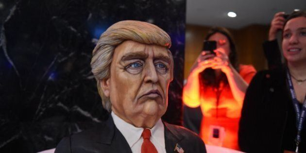 A cake in the likeness of Republican presidential nominee Donald Trump is on display at his election...