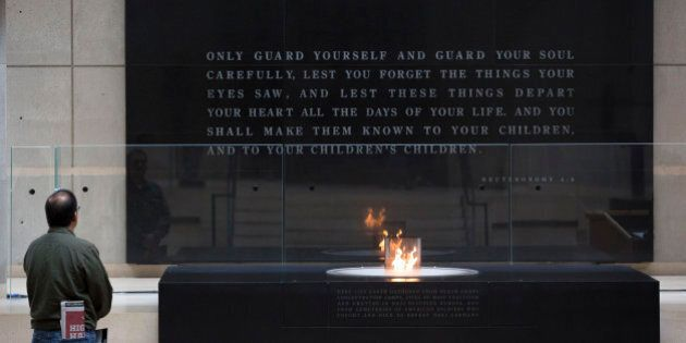 WASHINGTON, DC - MAY 2: A man pauses in front of the eternal flame during the annual Names Reading ceremony to commemorate those who perished in the Holocaust, in the Hall of Remembrance at the United States Holocaust Memorial Museum, May 2, 2016, in Washington, DC. Marking the anniversary of the Warsaw Ghetto Uprising, Holocaust Remembrance Day is an internationally recognized date corresponding to the 27th day of Nisan on the Hebrew calendar. In Hebrew, Holocaust Remembrance Day is called Yom Hashoah. This year Holocaust Remembrance Day begins in the evening of May 4 and ends in the evening of May 5. (Drew Angerer/Getty Images)