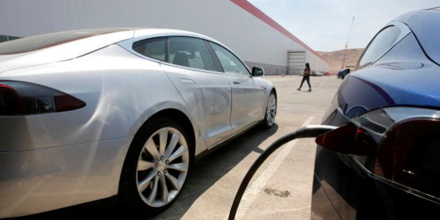 Tesla Motors model S cars are charged at the new Tesla Gigafactory, Tuesday, July 26, 2016, in Sparks,...