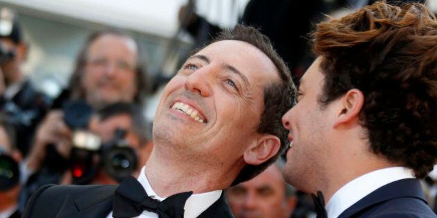Actors Gad Elmaleh (L) and Kev Adams pose on the red carpet as they arrive for the screening of the