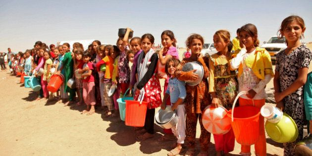 Displaced people from the minority Yazidi sect, fleeing violence in the Iraqi town of Sinjar west of...
