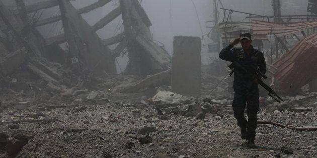 Mossoul, la seconde ville en importance d'Irak occupée par l'État islamique, est tombée aux mains des...