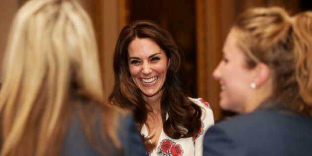 Britain's Catherine, Duchess of Cambridge, meets members of the British Olympic womens hockey team, as she meets athletes during a reception for Team GB's Olympic and Paralympic athletes, hosted by Britain's Queen Elizabeth II, at Buckingham Palace in central London on October 18, 2016.Britain's stars of this year's Olympic and Paralympic Games in Rio attended an 'amazing' reception at Buckingham Palace -- the official London home of Queen Elizabeth II -- on Tuesday. / AFP / POOL / Yui Mok        (Photo credit should read YUI MOK/AFP/Getty Images)