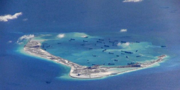 FILE PHOTO: Chinese dredging vessels are purportedly seen in the waters around Mischief Reef in the disputed...