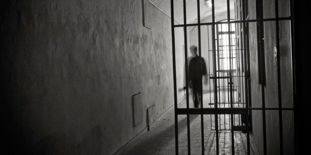 Silhouette of an inmate on prison's cell