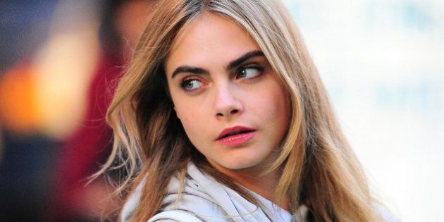 NEW YORK, NY - OCTOBER 15: Model Cara Delevingne is seen on the set of a DKNY photoshoot on October 15,...