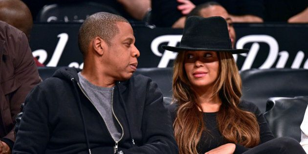 NEW YORK, NY - JANUARY 12: Jay-Z and Beyonce Knowles attend the Houston Rockets vs Brooklyn Nets game...