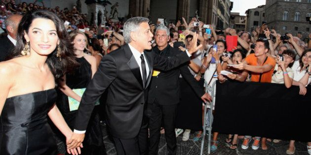 FLORENCE, ITALY - SEPTEMBER 07: Amal Alamuddin and George Clooney attend the Celebrity Fight Night In...