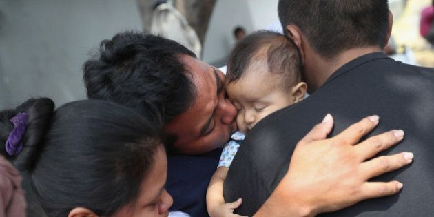 GUATEMALA CITY, GUATEMALA - FEBRUARY 09: Guatemalan deportee Eric Perez, 23, kisses his daughter Kimberly,...