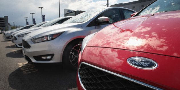 CHICAGO, IL - JUNE 20: Ford Focus compact cars are offered for sale at a dealership on June 20, 2017...