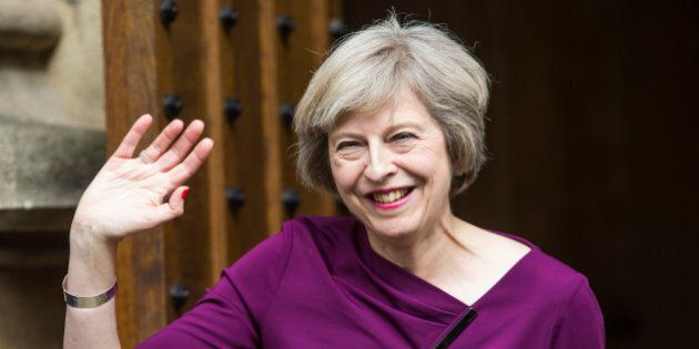 LONDON, ENGLAND - JULY 07: British Home Secretary and Conservative leadership contender Theresa May waves outside the Houses of Parliament on July 7, 2016 in London, England. Theresa May has the backing of 199 fellow MPs after the second ballot for the leadership of the Conservative Party. Receiving 84 votes, Andrea Leadsom MP joins May on the shortlist presented to the Conservative Party members and Michael Gove was eliminated with 46 votes. (Photo by Jack Taylor/Getty Images)
