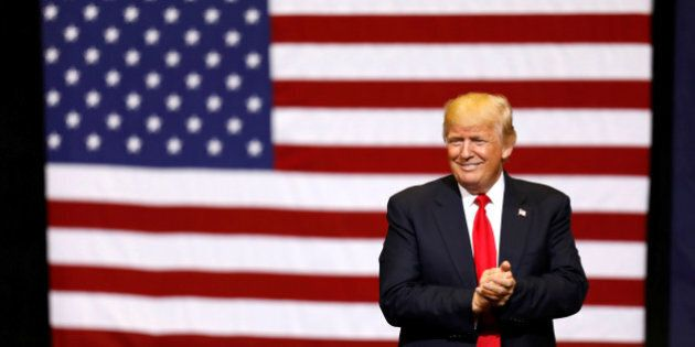 U.S. President Donald Trump takes the stage for a rally at the U.S. Cellular Center in Cedar Rapids,...