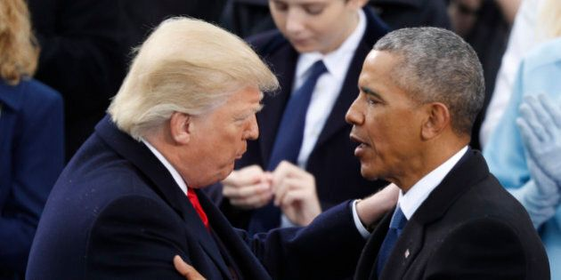 U.S. President Donald Trump (L) greets former President Barack Obama after being sworn in as the 45th...