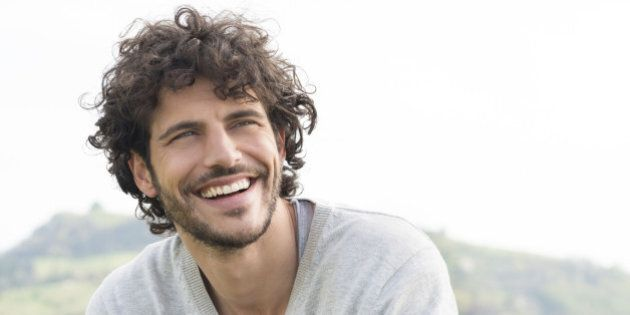 Portrait Of Young Handsome Man Smiling