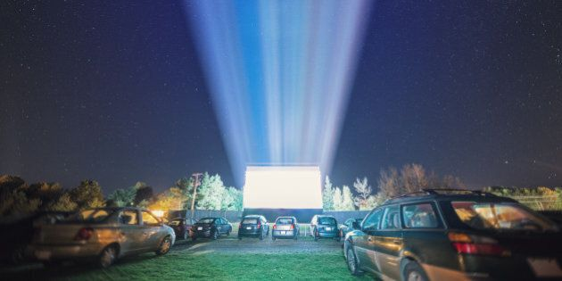 Drive in movie goers enjoy a screening under clear Autumn skies. Long