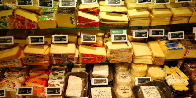 Various cheese is offered at a supermarket of Swiss retail group Coop in Zumikon, Switzerland December...