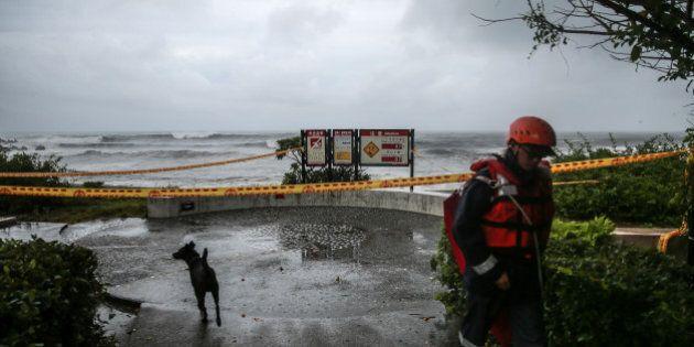 YILAN, TAIWAN - JULY 07: A Taiwanese coast guard keeps watch on the coastline of Yilan as typhoon Nepartak...