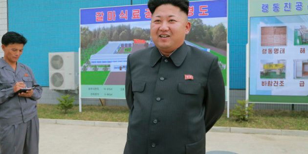 North Korean leader Kim Jung Un visits the newly commissioned Kalma Foodstuff Factory in this undated...