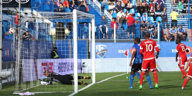 Jul 2, 2016; Montreal, Quebec, CAN; New England Revolution forward Kei Kamara (13) scores a goal against...