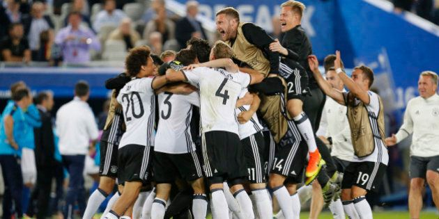 The German team celebrate after winning the Euro 2016 quarterfinal soccer match between Germany and Italy,...