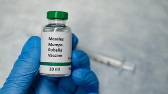 A fake MMR vaccine vial holding in hand