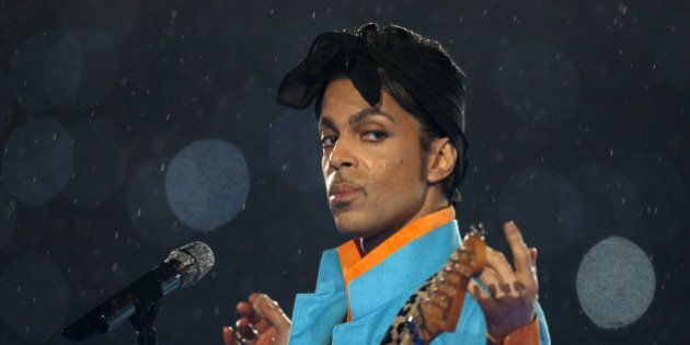 Prince performs during the halftime show of the NFL's Super Bowl XLI football game between the Chicago...