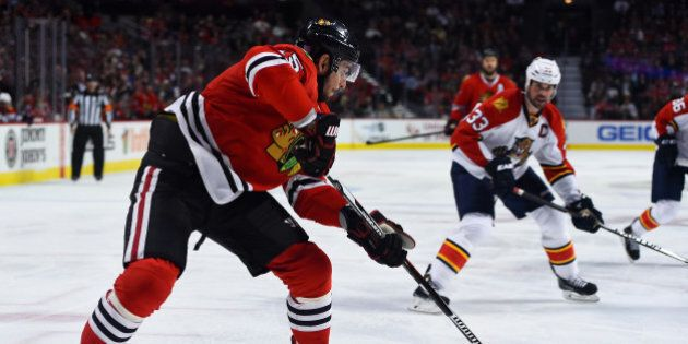 Oct 22, 2015; Chicago, IL, USA;  Chicago Blackhawks center Andrew Shaw (65) shoots the puck against the Florida Panthers during the third period at the United Center. Chicago Blackhawks defeat the Florida Panthers 3-2. Mandatory Credit: Mike DiNovo-USA TODAY Sports
