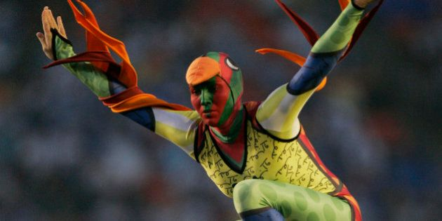 A Cirque du Soleil performer is seen during the pre-game show for the Super Bowl XLI football game at Dolphin Stadium in Miami on Sunday, Feb. 4, 2007. (AP Photo/Mark J. Terrill)