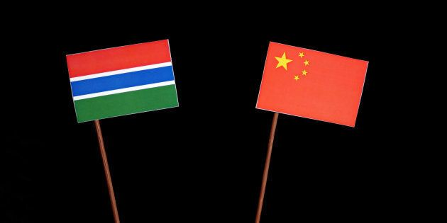 Gambian flag with Chinese flag isolated on black