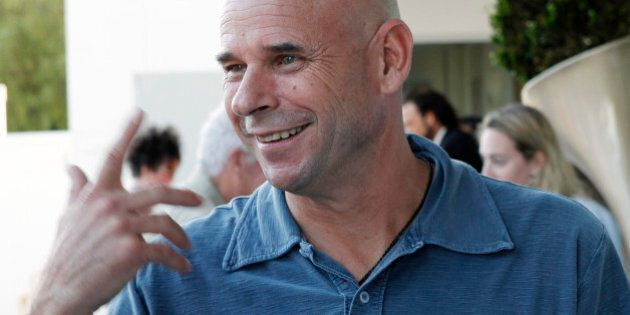 Cirque du Soleil founder Guy Laliberte smiles at a party promoting his new book 'Gaia' at the SLS hotel...