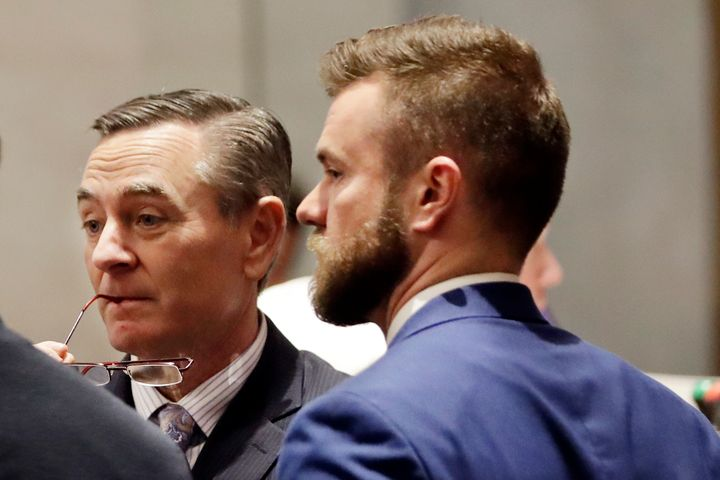 House Speaker Glen Casada (R-Franklin), left, talks with Cade Cothren, right, his chief of staff, during a House session in Nashville, Tenn. Cothren has resigned amid allegations of sending racist and sexually explicit texts.