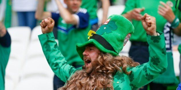 LYON, FRANCE - JUNE 16: Irish fans support their team during the UEFA EURO 2016 Group E match between...