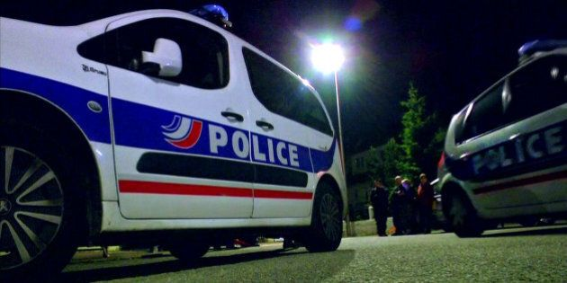 Still image taken from video shows Police vehicles at the scene near where a French police commander...