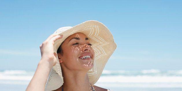 Woman wearing sun hat on