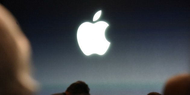 The Apple Inc. logo is seen before the start of an Apple Inc. event in Cupertino, California, U.S., on...