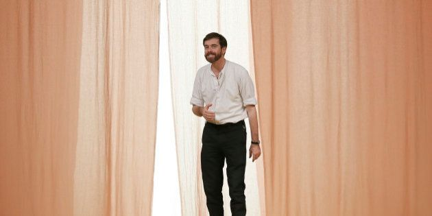 French designer Christophe Lemaire appears at the end of his Spring/Summer 2015 women's ready-to-wear...