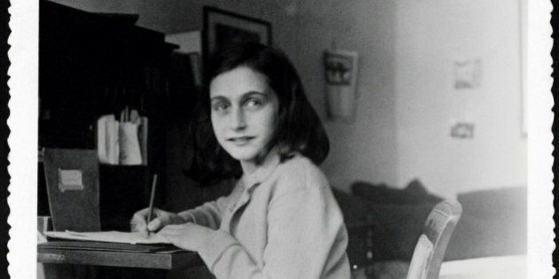 - HANDOUT PHOTO - A hand out picture received on December 17, 2004 shows Anne Frank at her desk in her...
