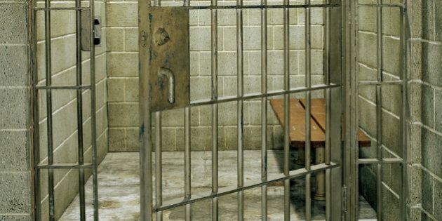 Empty prison cell with door