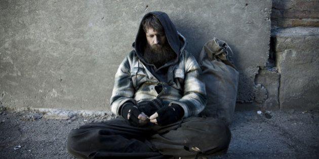 USA, Utah, Salt Lake City, Homeless man with sack sitting on