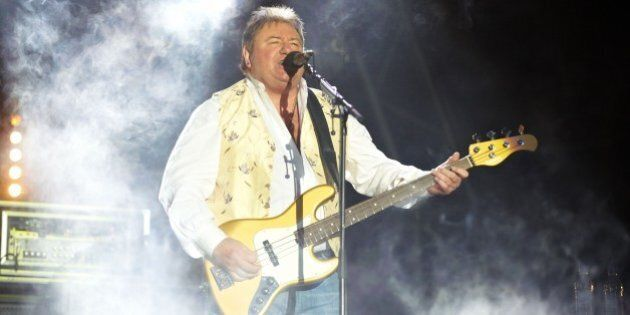 LONDON, UNITED KINGDOM - JULY 25: Greg Lake of Emerson Lake and Palmer performs on stage during day two...