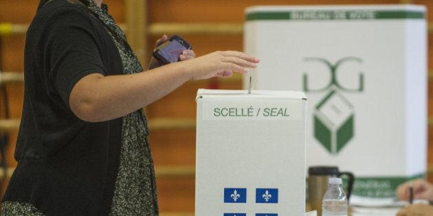 People vote on September 4, 2012 in l'Assomption, Quebec, Canada. Voting started Tuesday in a Quebec...