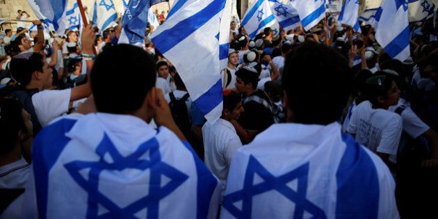 Israelis carry flags during a march marking Jerusalem Day, the anniversary of Israel's capture of East Jerusalem during the 1967 Middle East war, just outside Damascus Gate of Jerusalem's Old City June 5, 2016. REUTERS/Ammar Awad
