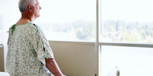 Senior male patient looking out window in