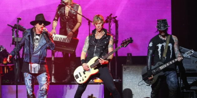 FILE - In this April 23, 2014 file photo, Axl Rose, from left, Duff McKagan and DJ Ashba of Guns N' Roses...