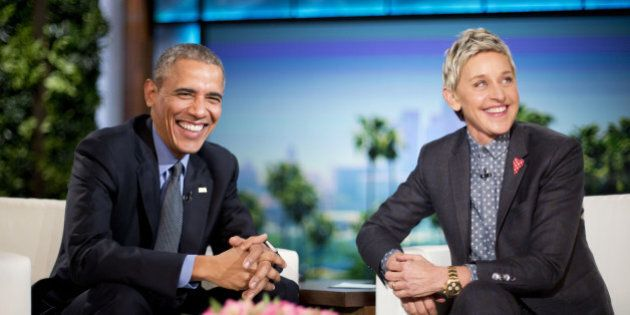 President Barack Obama talks with Ellen DeGeneres during a commercial break while taping a show segment...
